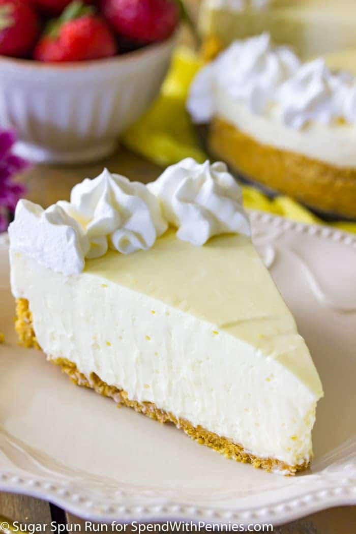 A creamy, tart, no-bake lemon cheesecake that can be made in minutes without ever turning on the oven! Served over a simple graham cracker crust, this sweet & tart summertime treat is a simple party pleaser that's perfect for your next get-together!