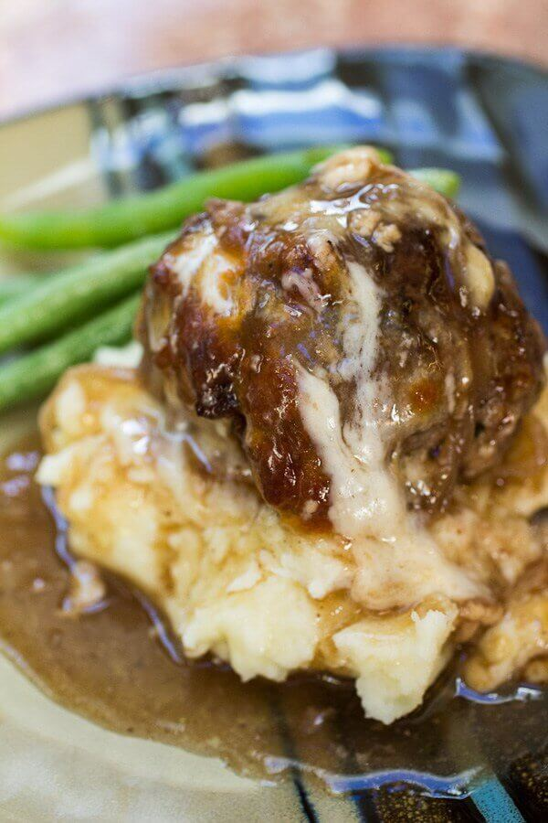 French Onion Stuffed Meatballs are the ULTIMATE comfort food. Combining the best of so many worlds with super-flavorful caramelized onions, tender, juicy meatballs, and lots of gooey cheese – these are SO worth the work.