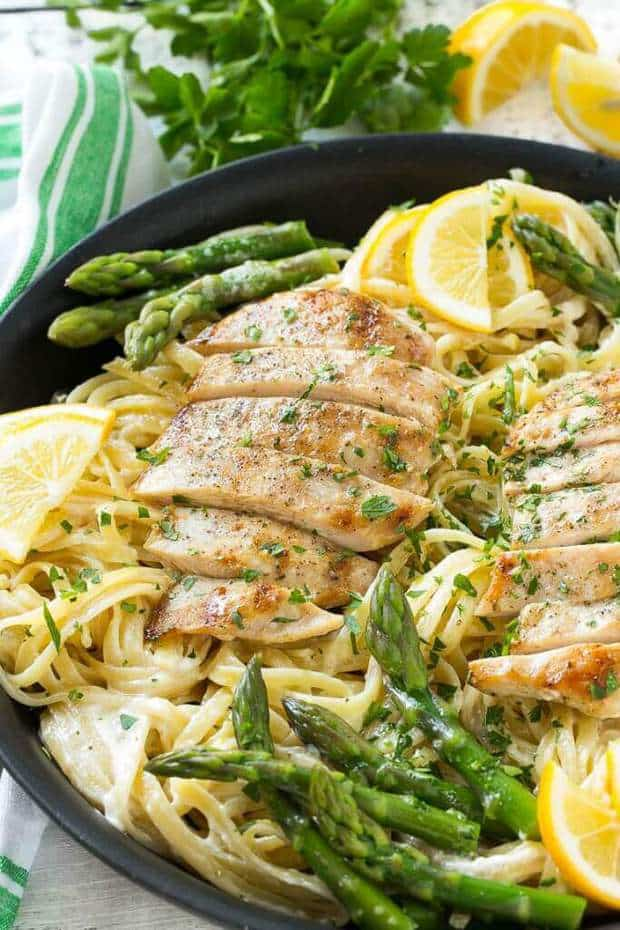 This recipe forLemon Asparagus Pasta with Grilled ChickenfromDinner at the Zoocombines tender asparagus and grilled chicken with pasta in the most delicious lemon cream sauce!