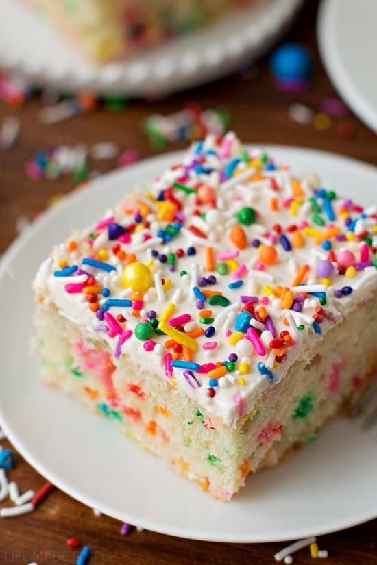 It's time to celebrate with this ultra fluffy homemade funfetti cake! It's bursting with sprinkles and topped with a fluffy vanilla buttercream. Bring on the birthdays!!