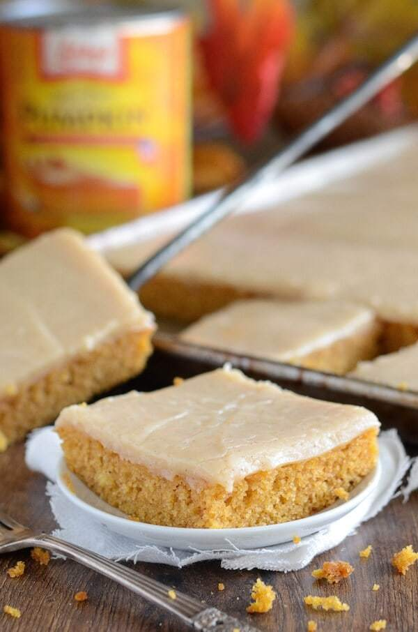 This Pumpkin Sheet Cake is a moist spiced pumpkin cake that uses melted butter for easiness. Then you pour on some gorgeous cinnamon cream cheese frosting that sinks a little into the cake as it cools. It's pure heaven.