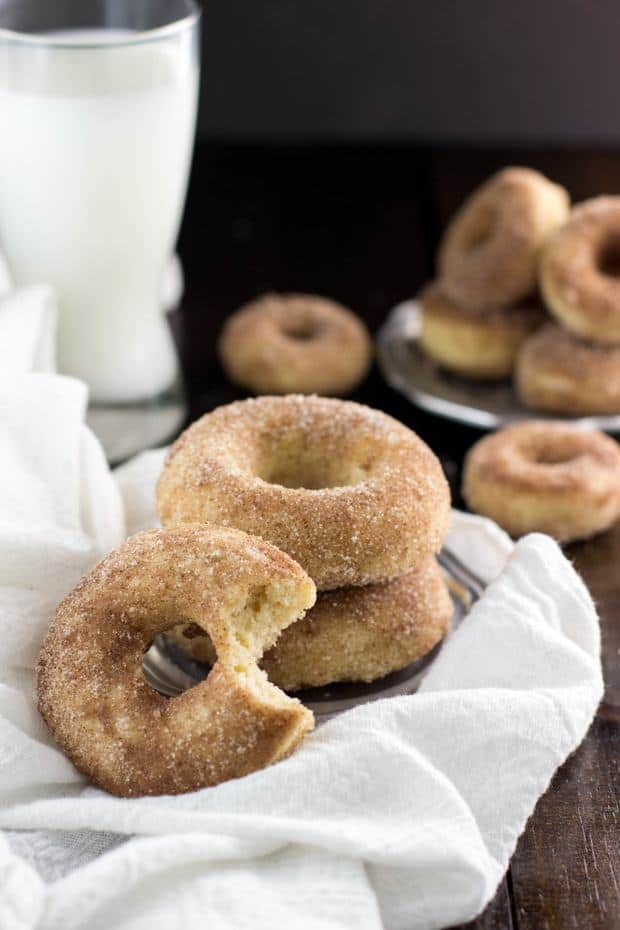 Baked Snickerdoodle Donuts made with cream of tartar (for that signature Snickerdoodle flavor) then brushed with butter and dunked in cinnamon sugar.