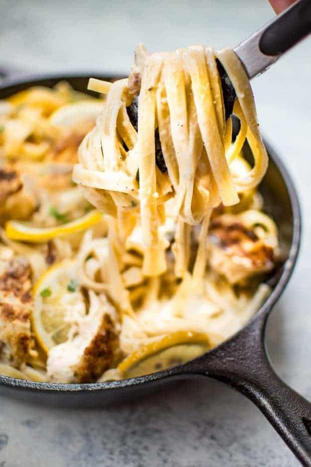 This Lemon Parmesan Chicken Alfredo recipe is a delicious and decadent way to enjoy pasta! The sauce is irresistibly creamy with plenty of lemon and garlic! The tender breaded chicken adds another layer of comfort and flavor to this easy fettuccine Alfredo pasta dish.