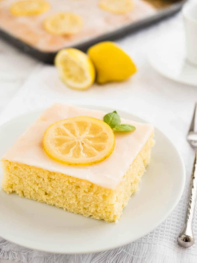 An easy lemon sheet cake recipe that is made in a 9×13-inch pan and has a delicious simple lemon glaze on top. This lemon cake tastes even better on the next day!