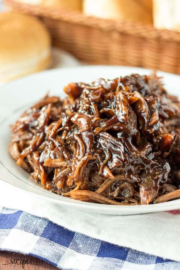 The BEST pulled pork! Slow Cooker Honey Balsamic Pulled Pork with an incredible thick, sweet and tangy honey balsamic sauce! Easy crockpot dinner. Includes step by step recipe video.