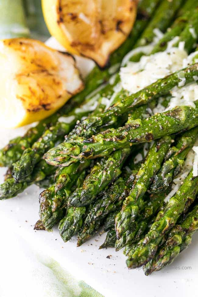 Lemon Parmesan Grilled Asparagus is a summer treat, perfect along side any steak or barbecued chicken dish! This easy recipe elevates a traditional grilled asparagus by adding a touch of parmesan cheese and a squeeze of grilled fresh lemon… easy enough for an everyday meal and amazing enough to wow your guests!