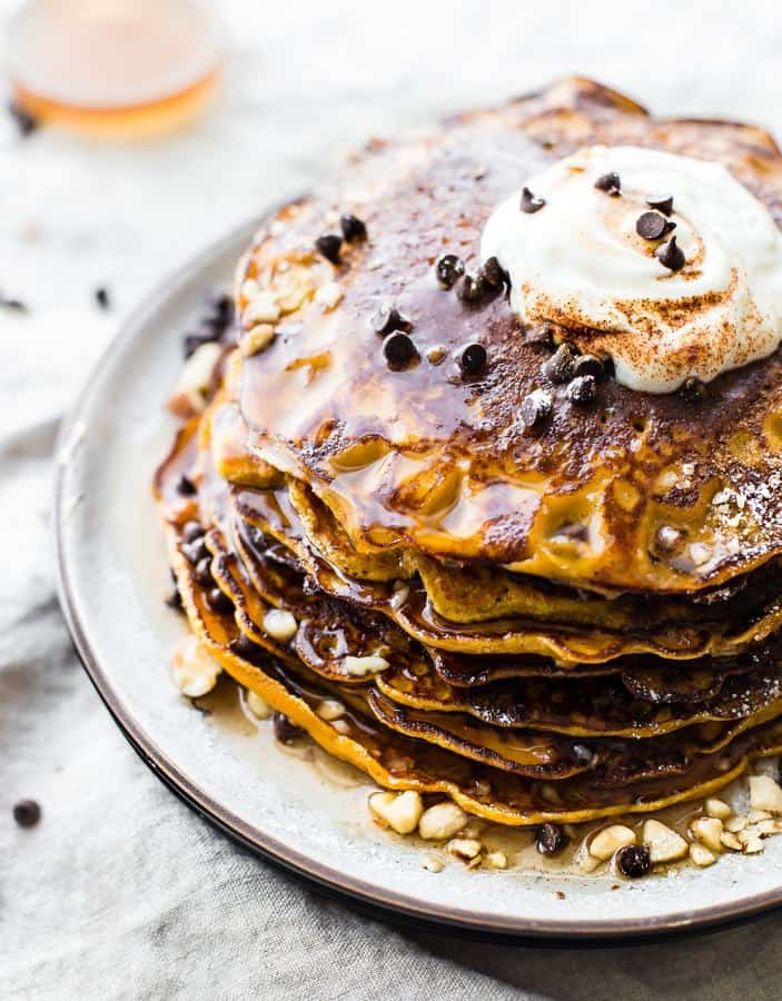 Flourless Carrot Cake Yogurt Pancakes are too good to be true! Protein packed, made with simple wholesome ingredients, lower sugar, gluten free, and oh so tasty! Just blend, cook, and serve!