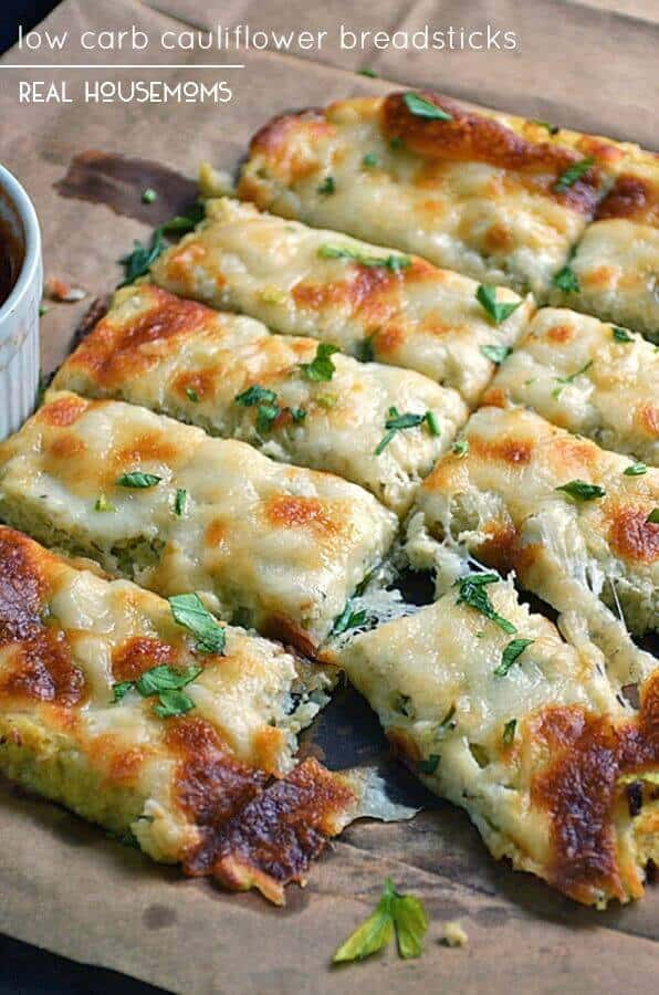 Low Carb Cauliflower Breadstickswith fresh herbs, garlic, and lots of ooey gooey cheese atop a cauliflower crust looks and tastes like cheesy bread!