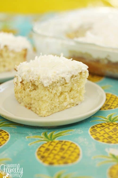 PPina Colada Poke Cake is bursting with coconut and pineapple. The topping on this cake is to die for! It is the perfect summer dessert!
