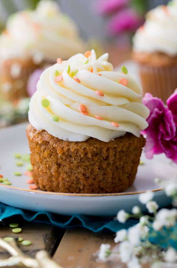 Soft, fluffy, and moist carrot cake cupcakes! Made completely from scratch with real grated carrots and the option to add nuts or raisins, these cupcakes are always a hit! Make sure to top them off with the absolute best cream cheese frosting