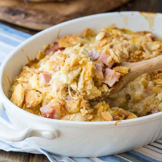 A delicious chicken casserole with all the ingredients of chicken cordon bleu: chicken, ham, swiss cheese all baked together over white rice. I've made it extra-flavorful by adding some cheddar cheese and a buttery Ritz cracker crumb topping.
