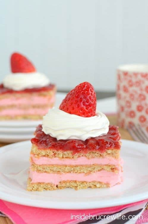 Layers of strawberry pudding, graham crackers, and strawberry jam makes this Strawberry Shortcake Eclair Cake such a delicious no bake treat. It is the perfect dessert to satisfy that sweet tooth when you are short on time.