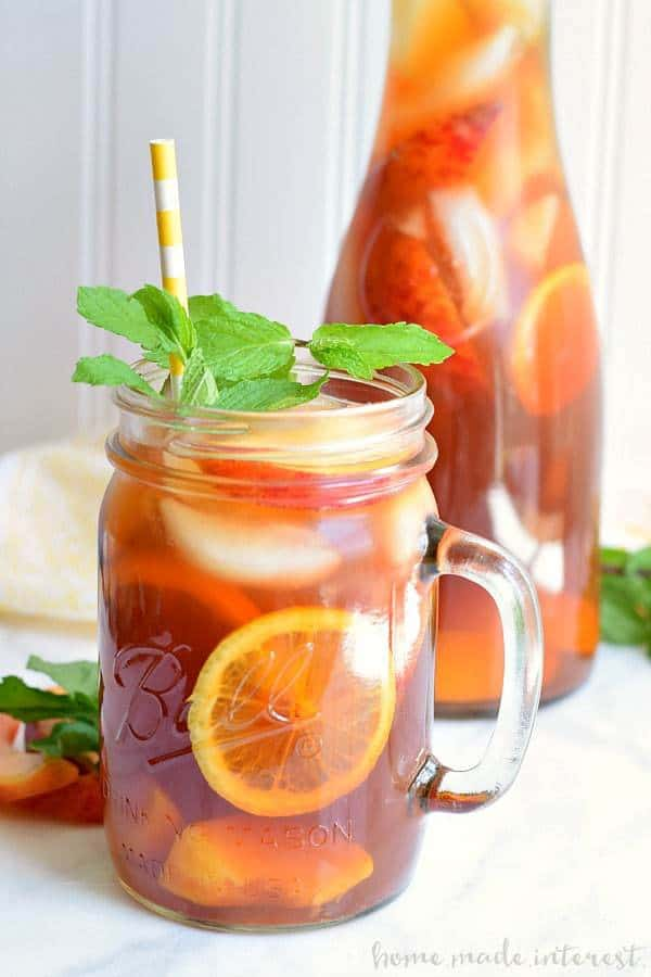 Spiked Peach Sweet Tea with and filled it with frozen peaches for a summer cocktail recipe that is perfect for sipping on a warm summer night.