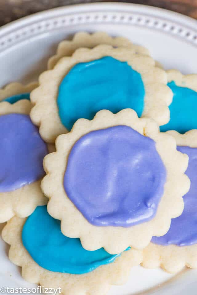 CThese cream cheese sugar cookies are super soft and so easy to make. They're so delicious topped with a simple powdered sugar frosting.
