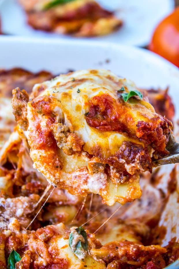 Easy Cheesy Ravioli Lasagna is a hearty no-brainer dinner to make on busy back-to-school nights. You don't even have to cook the ravioli, just throw it in frozen. It's a total crowd-pleaser! And a great make-ahead meal too.