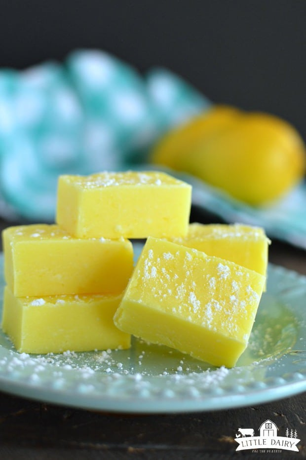 There is something magical about adding Lemon Fudge to holiday goody plates! I'm not sure if it's the pretty bright yellow color, or the refreshing lemon flavor that makes it such a stand out! Either way, you are going to fall in love with Lemon Fudge and people are going to beg you for the recipe!