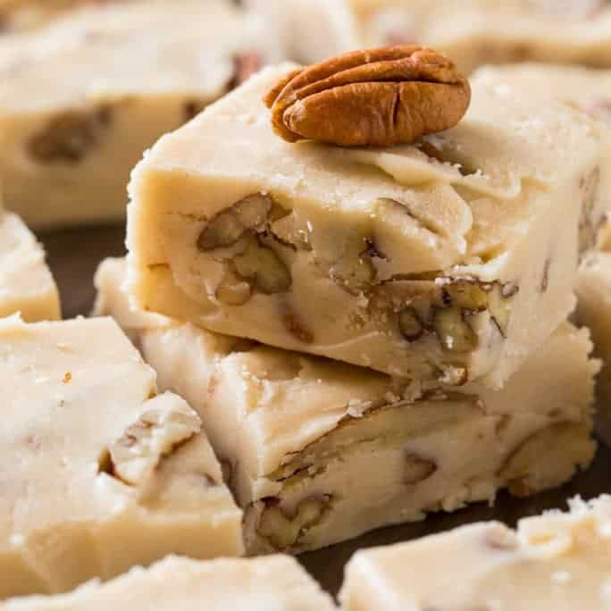 Butter Pecan Fudge is wonderfully buttery and creamy with little bits of crunchy toasted pecans. It's perfect for when you're craving fudge, but not something chocolate and it makes a wonderful holiday treat for gift giving.