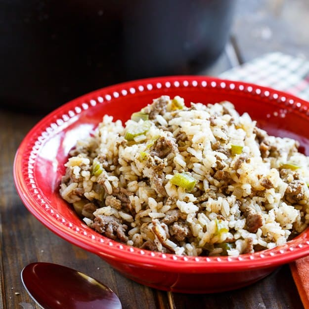 """Dirty Rice is a spicy and flavorful Cajun rice dish made from white rice. It gets its """"dirty"""" color from finely chopped chicken livers and ground beef or pork. The chicken livers give it such a deep flavor. Even if you think you don't like chicken livers, you should try adding them. Since they are finely chopped, the overall dish doesn't have much of a chicken liver flavor."""