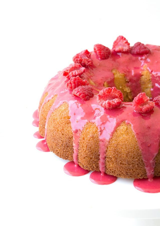 I'm so excited to introduce you to this Glazed Lemon Bundt Cake. One with a soft and flavourful crumb and a tart but sweet drippy raspberry glaze.