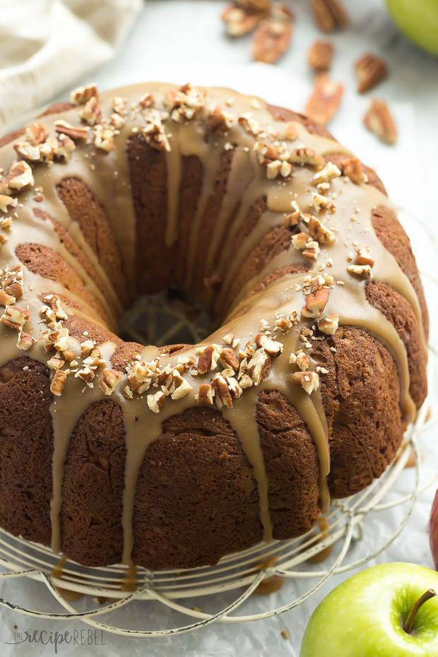 Praline Apple Bundt Cake is loaded with apples, pecans and covered in a brown sugar praline glaze — the perfect fall dessert!
