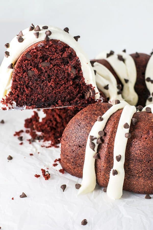 A Nothing Bundt Cake copycat recipe that hits the mark: ultra moist red velvet bundt cake topped with deliciously fluffy cream cheese frosting.