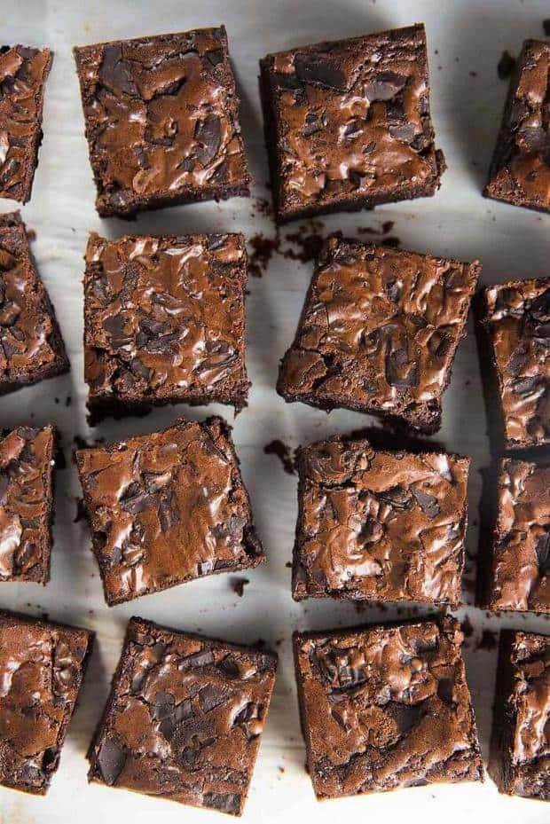 The Best Fudgy Chocolate Brownies Ever recipe uses cocoa powder (instead of melted chocolate) to make double fudge cocoa brownies that are slightly chewy and fudgy at the edges of the pan, while the middle pieces are super fudgy.