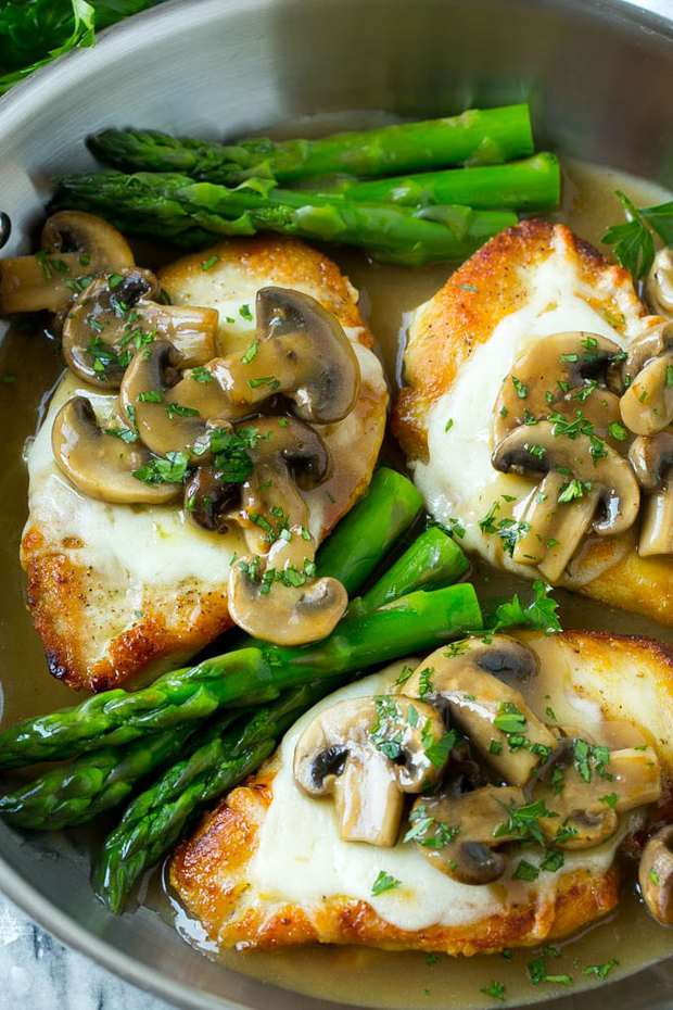 This chicken madeira recipe is even better than the Cheesecake Factory version! Chicken breasts are smothered in mozzarella cheese, the most delicious mushroom sauce, and served alongside asparagus. The perfect dinner for any occasion!