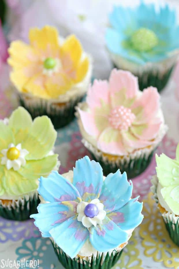 Looking for a cute spring dessert? These Easy Chocolate Flower Cupcakes are simple, fun, and perfect for birthdays and showers! They feature a delicious lemon cupcake, fluffy coconut frosting, and simple, beautiful chocolate flowers on top.