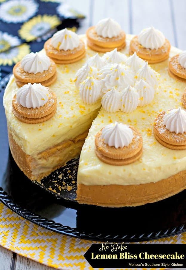 ThisNo Bake Lemon Bliss CheesecakefromMelissa's Southern Style Kitchenis for all the lemon lovers in your life. A crushed lemon creme cookie crust is filled with a luscious lemon cheesecake and more cookies!