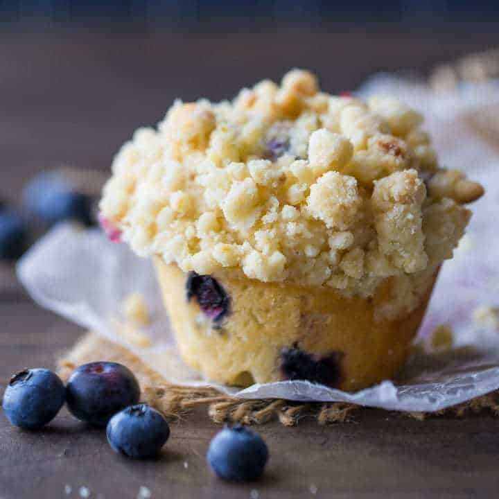 Simply Perfect Blueberry Muffins are amazing! These muffins are light and moist, studded throughout with sweet berries, and sprinkled with a crunchy, buttery streusel crumb topping. They're quick and easy to make, so whip up a batch for breakfast or brunch!