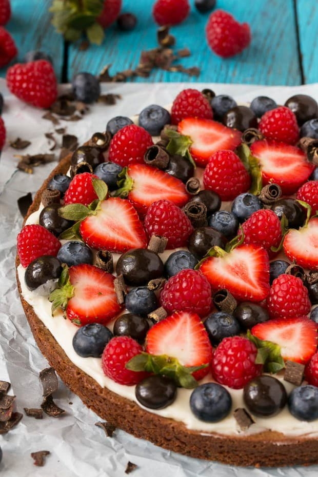 A rich brownie crust topped with cream cheese frosting and lots of fresh berries.