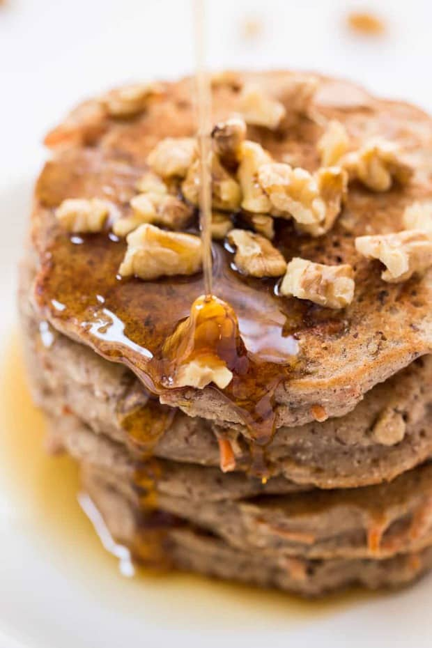 These healthy carrot cake pancakes are packed with nutritious ingredients like quinoa, almond, flax and coconut! The perfect way to kickstart your day with a breakfast that tastes like dessert!