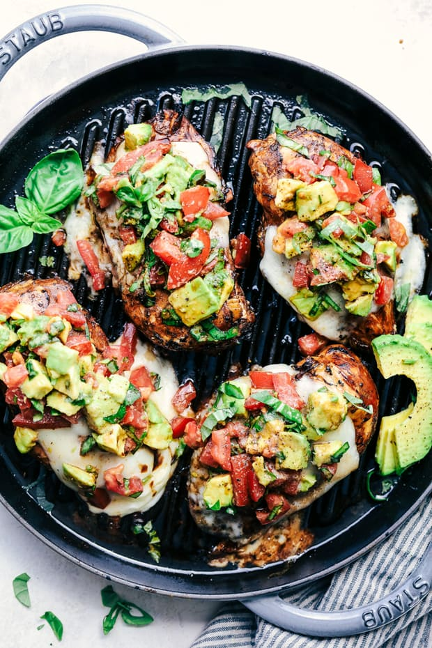 Grilled California Avocado Chicken marinates in an amazing honey garlic balsamic sauce and is grilled to perfection! It is topped with a thick slice of mozzarella cheese and avocados, tomatoes and basil. This chicken is INCREDIBLE!!