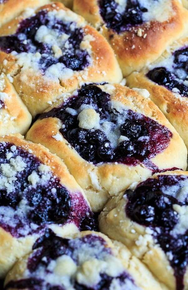 Blueberry Kolaches are made from a sweetened yeast dough and filled with a simple, fresh blueberry filling and a streusel topping. They are as tasty as they are pretty.