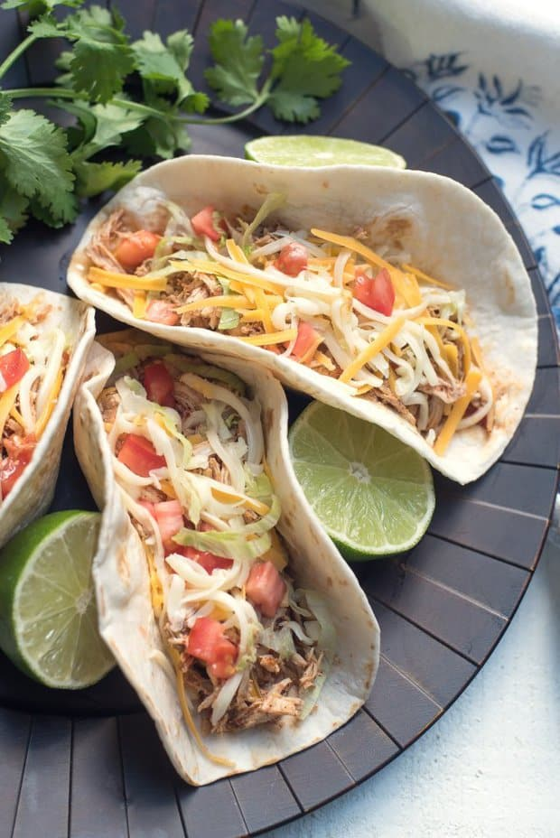 This recipe for Crock-Pot Chicken Tacos creates flavorful, incredibly tender shredded chicken that works beautifully in a variety of Mexican dishes. It is at the top of my list of favorite busy day slow cooker recipes!