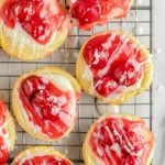 Cherry danish with icing on cooling rack