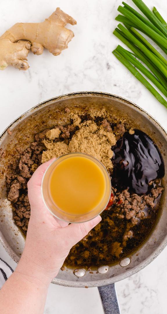 adding chili paste, soy sauce, brown sugar, hoisin sauce, and the beef chili paste, soy sauce, brown sugar, hoisin sauce, and ½ of the beef broth to the skillet