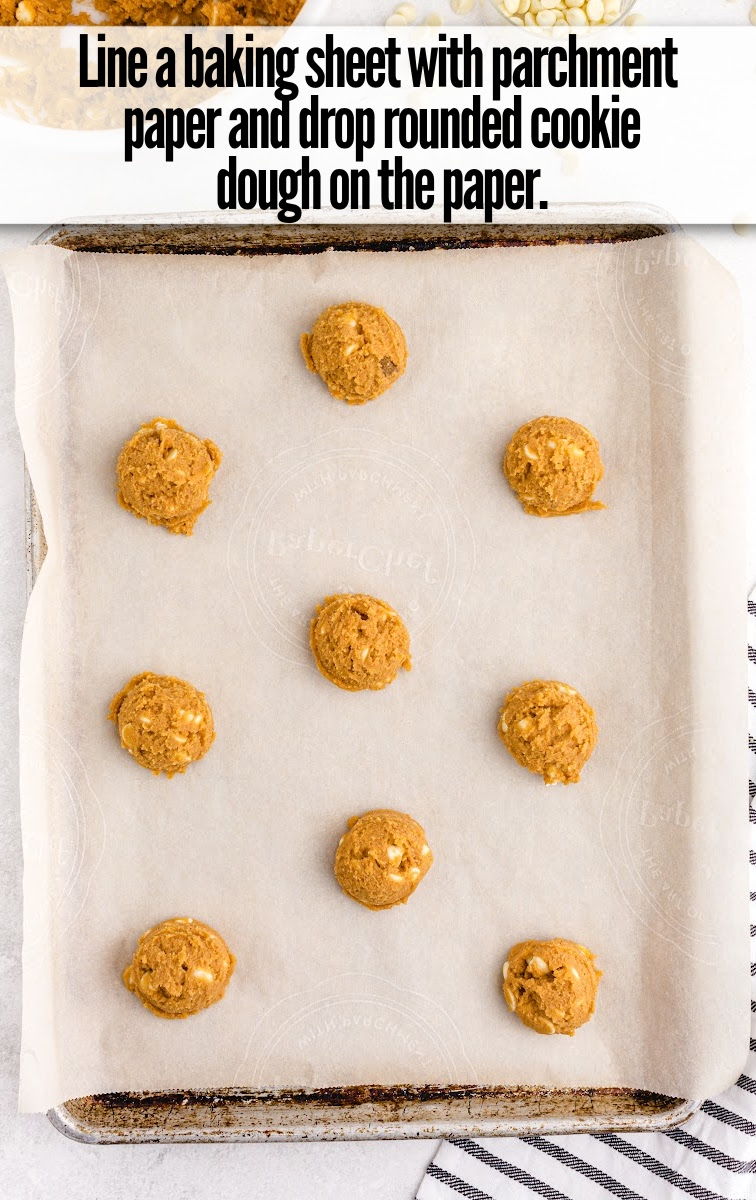 lined Pumpkin Spice Pudding Cookies dough in baking sheet