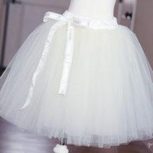 White tutu with white ribbon on dress form