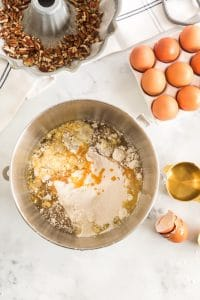 pudding, cake mix, egg, and rum in mixing bowl