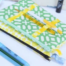 Pencil Pouch Sewing Tutorial - a cool twist on the classic zip pencil pouch with accessible pen storage on the outside!