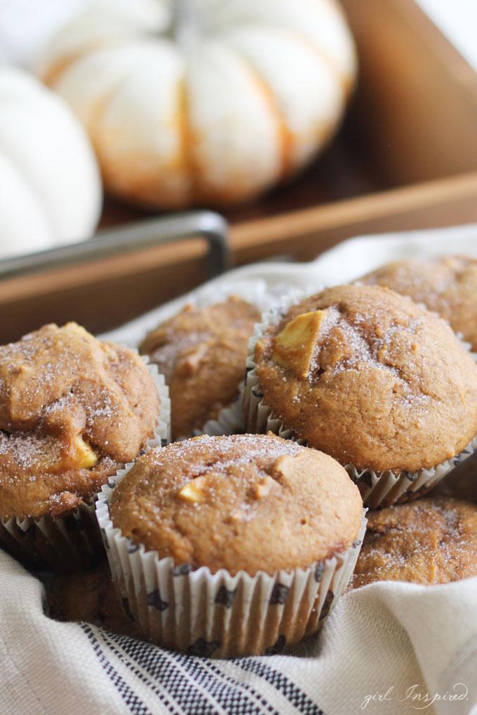pumpkin apple muffins on dish towel, mini pumpkins in background