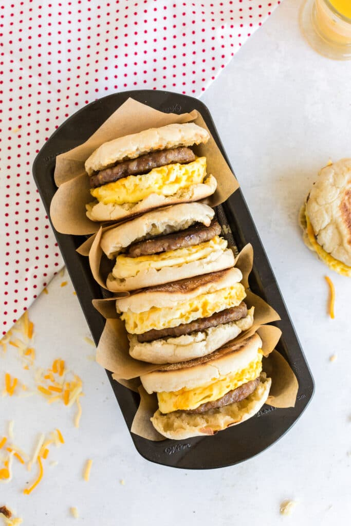 four breakfast sandwiches in metal loaf pan red and white polka dot linen