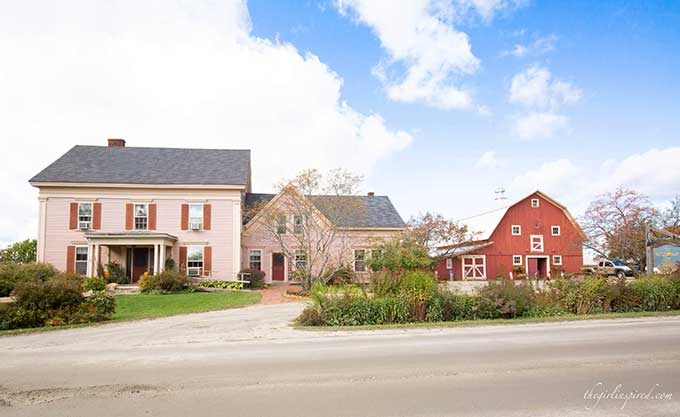 pink farmhouse and red barn