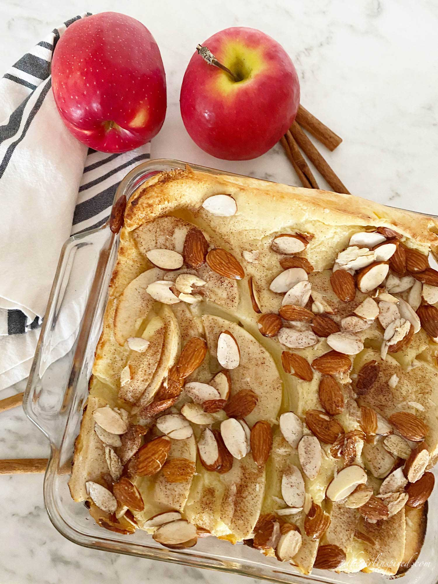 German pancake with red apples, sliced almonds
