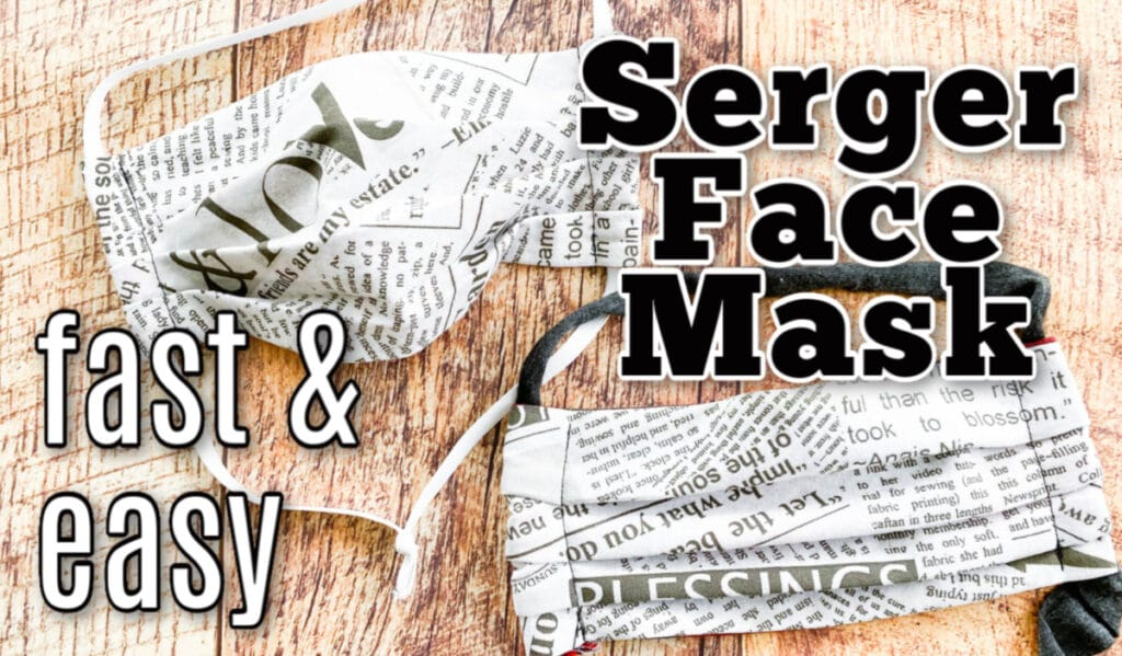 finished serged newsprint fabric mask on wood plank background with text overlay
