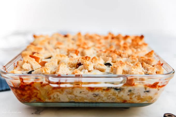 Glass casserole dish with tuna casserole and toasted breadcrumbs