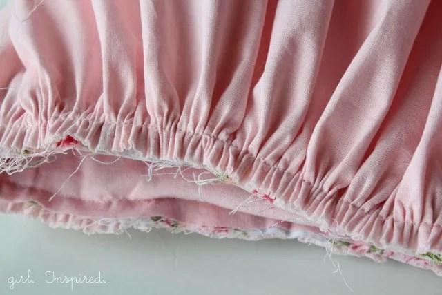 closeup of finished gathering stitch on pink fabric