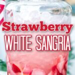 strawberry sangria in large glass drink dispenser on pedestal stand, lemon wedges and fresh berries in wine glasses on table and American flag in the background with text overlay