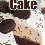 oreo ice cream cake with slice removed on white plate with aqua linen